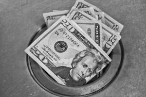 throwing money down drain