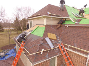 roofers installing shingles on a house (DIY Roof)