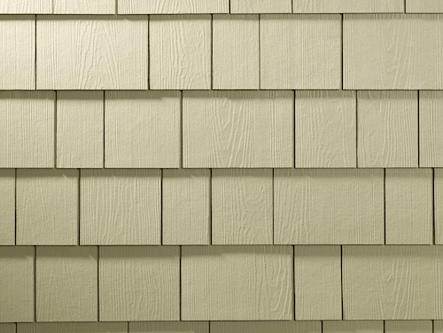 Close-up shot of straight-edge shingle siding in a beige color.