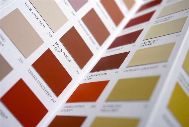 An open page with squares of different colored paint samples, shades of browns and reds.