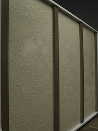 A wall of stucco siding in a beige color with small brown batten boards laid vertically.