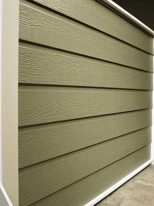 An olive color wall with dutch lap siding in a cedar finish.