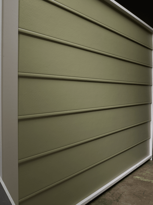 Beaded seam siding with a smooth finish in an olive green color.