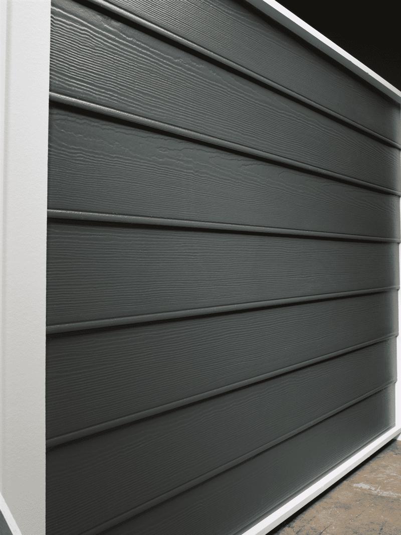 Navy blue beaded seam horizontal siding wall with a cedar finish.